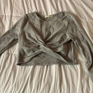 A gray sleeved crop top.